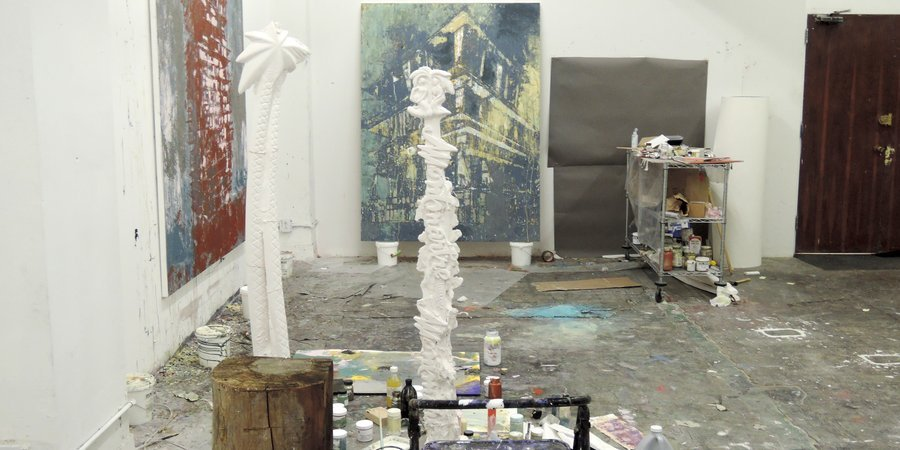 A view of the paintings and sculptures Perez currently has in the works at his studio.