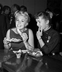 Kim Novak and Debbie Reynolds at Schwabs, by Frank Worth
