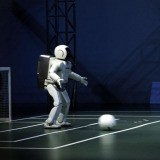 Hiroji Kubota, Japan. Fukuoka. June 2002. Honda ASIMO robots play soccer at RoboCup2002.