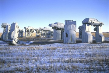 "USA. Alliance, Nebraska. 1991. Jim Reindors, a sculptor, was so inspired by Stonehenge in England that he and his relatives built their own ""Carhenge"" during a family reunion in Alliance in 1987., by Hiroji Kubota"