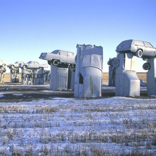 "USA. Alliance, Nebraska. 1991. Jim Reindors, a sculptor, was so inspired by Stonehenge in England that he and his relatives built their own ""Carhenge"" during a family reunion in Alliance in 1987. art for sale"