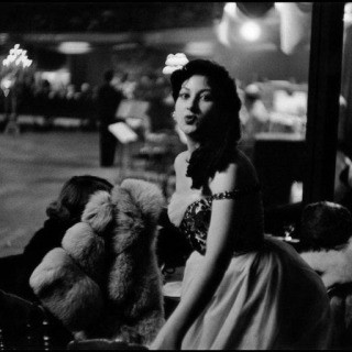 Inge Morath, France. Paris. 1955. An elegant guest. Once the show was over the dancing began and continued until four in the morning. The dance orchestra consisted of Roby Davis, with Claude Normand at the Hammond organ.