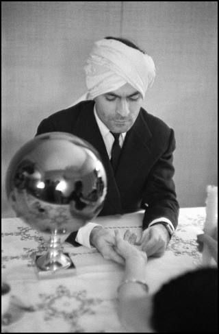 Cristobal Balenciega with turban, by Inge Morath