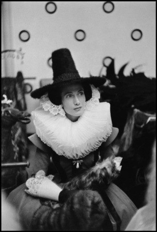 "France. Paris. 1955. Mme Marcel Rochas waits for her entrance for the number ""On the Canals of Amsterdam"". Her costume was created and donated by Hubert de Givenchy., by Inge Morath"