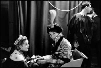 "France. Paris. 1955. Princess Troubetzkoy in her costume as Prince Youssoupoff relaxes in a sleigh with Countess Marina Cicogna. Costumes for the ""Arrival of Prince Youssoupoff at the Court of Ivan the Terrible"" were created and donated by Jaques Heim, wh, by Inge Morath"