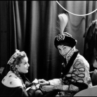 Inge Morath, France. Paris. 1955. Princess Troubetzkoy in her costume as Prince Youssoupoff relaxes in a sleigh with Countess Marina Cicogna. Costumes for the &quot;Arrival of Prince Youssoupoff at the Court of Ivan the Terrible&quot; were created and donated by Jaques Heim, wh