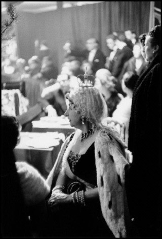 France. Paris. 1955. Violet Trefusis as Anne of Russia relaxes in the audience. Her costume was designed and donated by M. Gregorio Pomar who also performed with Count Guy de la Biliais as The Double Eagle., by Inge Morath