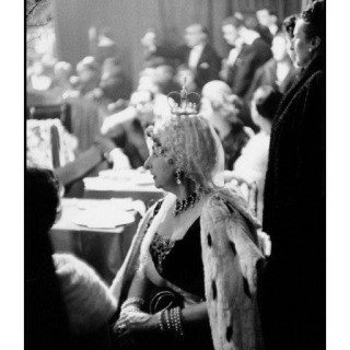 Inge Morath, France. Paris. 1955. Violet Trefusis as Anne of Russia relaxes in the audience. Her costume was designed and donated by M. Gregorio Pomar who also performed with Count Guy de la Biliais as The Double Eagle.