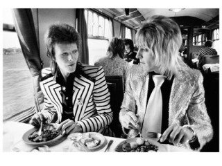 David Bowie and Mick Ronson, Lunch on Train to Aberdeen, UK, by Mick Rock