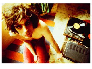 Syd Barrett with Record Player, Earls Court, London, by Mick Rock