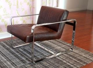 "1. Mitchell Gold + Bob Williams Armand Leather Chair<br> Stainless Steel Finish<br> Color: Brown<br> 29""W x 33""D x 32""H<br>$995"